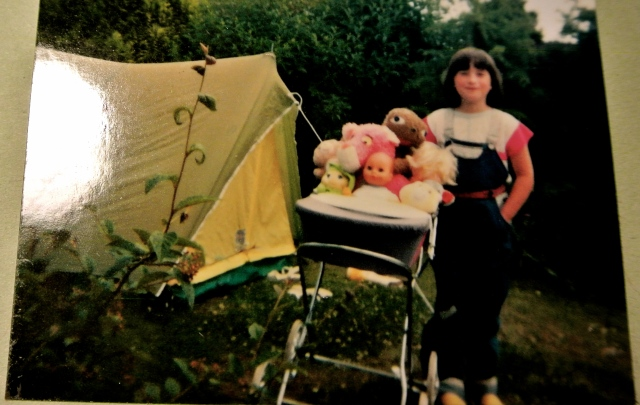 Me, sometime in the late 1980s with my entourage of plush toys - E.T is amongst them, of course!